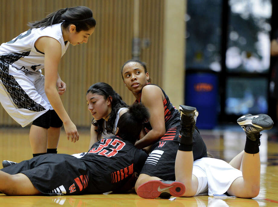 A group of Wagner and Clark players go after a loose ball on the floor during a 5A girls second round playoff basketball game between the Wagner Thunderbirds and the Clark Cougars at the UTSA Convocation Center, Thursday, February 14, 2013.  John Albright / Special to the Express-News. Photo: JOHN ALBRIGHT, San Antonio Express-News / San Antonio Express-News