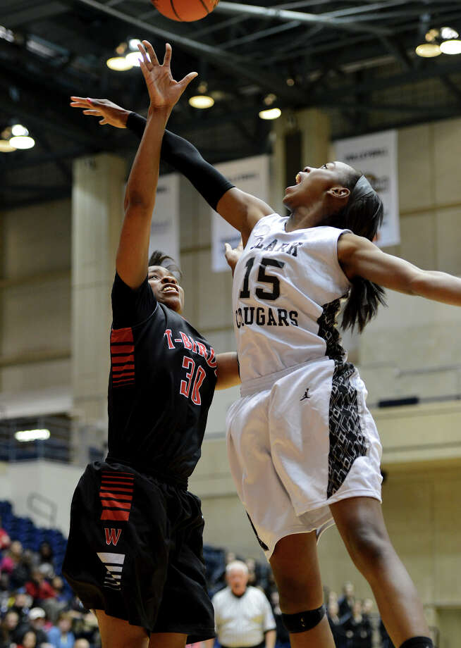 Wagner's Tesha Smith (30) gets off a shot as Clark's Trei Torain (15) defends during a 5A girls second round playoff basketball game between the Wagner Thunderbirds and the Clark Cougars at the UTSA Convocation Center, Thursday, February 14, 2013.  John Albright / Special to the Express-News. Photo: JOHN ALBRIGHT, San Antonio Express-News / San Antonio Express-News