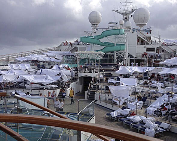 Passengers created makeshift tents on the deck of the Carnival Triumph to get away from dank rooms. Photo: Kalin Hill, FRE / Kalin Hill