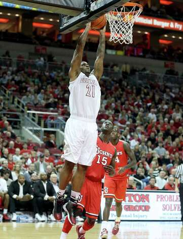LOUISVILLE, KY - FEBRUARY 14: Chane Behanan #21 of the Louisville Cardinals dunks the ball during the game against the St. John's Red Storm during the game at KFC YUM! Center on February 14, 2013 in Louisville, Kentucky.  (Photo by Andy Lyons/Getty Images) Photo: Andy Lyons