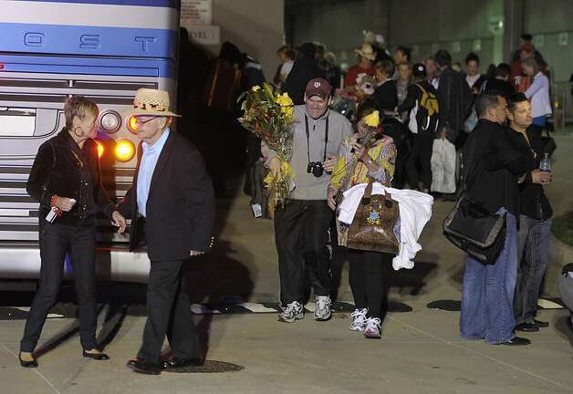 Passengers of the Carnival Triumph walk to their buses after docking at the cruise terminal in Mobile, Ala., Thursday, Feb. 14, 2013. The passengers will be bused to New Orleans for the night. The ship with more than 4,200 passengers and crew members has been idled for nearly a week in the Gulf of Mexico following an engine room fire. (AP Photo/G M Andrews) Photo: G M Andrews, Associated Press