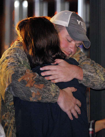 James Enmon hugs his aunt Kristi Conn, both of Orange, after departing the Triumph. (AP Photo/G M Andrews) Photo: G M Andrews, Associated Press / FR35697 AP