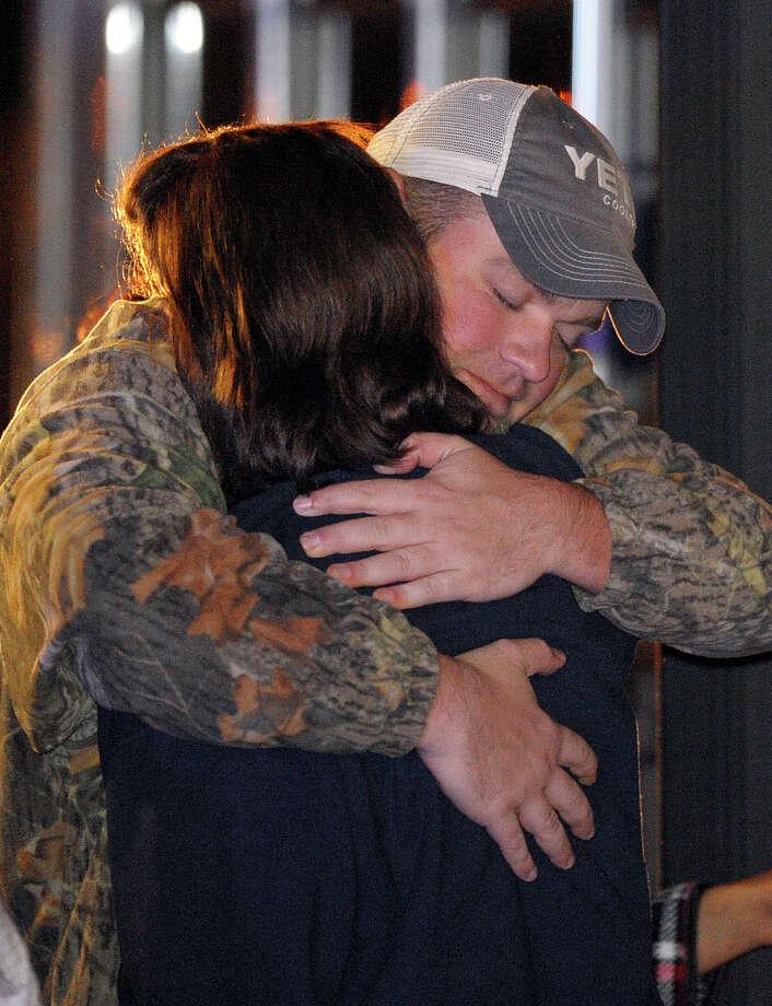 James Enmon hugs his aunt Kristi Conn, both of Orange, after departing the Triumph. (AP Photo/G M Andrews) Photo: G M Andrews, Associated Press / FR35697 AP