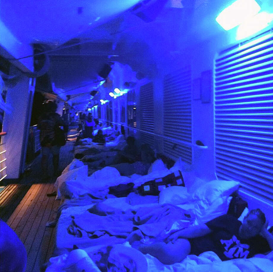 An Instagram photo provided by a passenger of the Carnival Cruise Ship Triumph identifying himself as Mikemoonpie shows passengers laying on mattresses on the third deck of the ship on Wednesday. Photo: MIKEMOONPIE, AFP/Getty Images / AFP