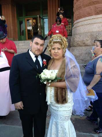 Jose A. Rivas and Suri Zuniga wed at the noon ceremony at Bexar County Courthouse on Valentine's Day. Photo: Sarah Tressler/Express-News