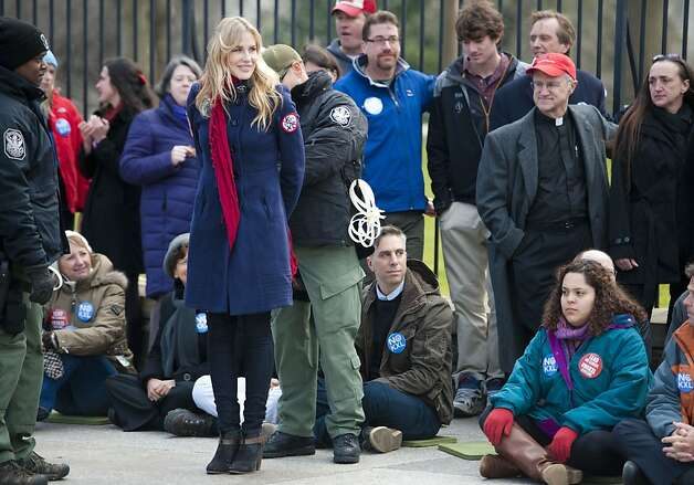 Daryl Hannah is handcuffed and arrested during the Keystone XL Pipeline Protest at Lafayette Park on February 13, 2013 in Washington, DC.  Photo: Leigh Vogel, Getty Images