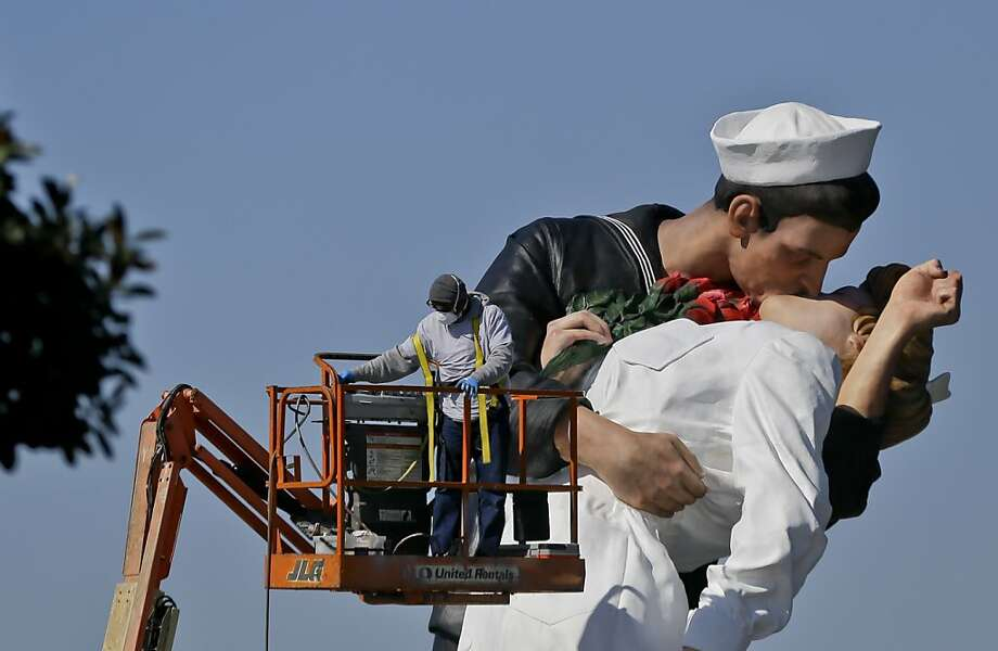 Workman put the finishing touches to the new kissing sailor statue on the embarcadero adjacent the USS Midway museum Thursday Feb. 14, 2013 in San Diego. The statue, which was modeled after the  photograph by Alfred Eisenstaedt taken at the end of World War II, replaces a similar version that was moved out of San Diego last year.  Photo: Lenny Ignelzi, Associated Press