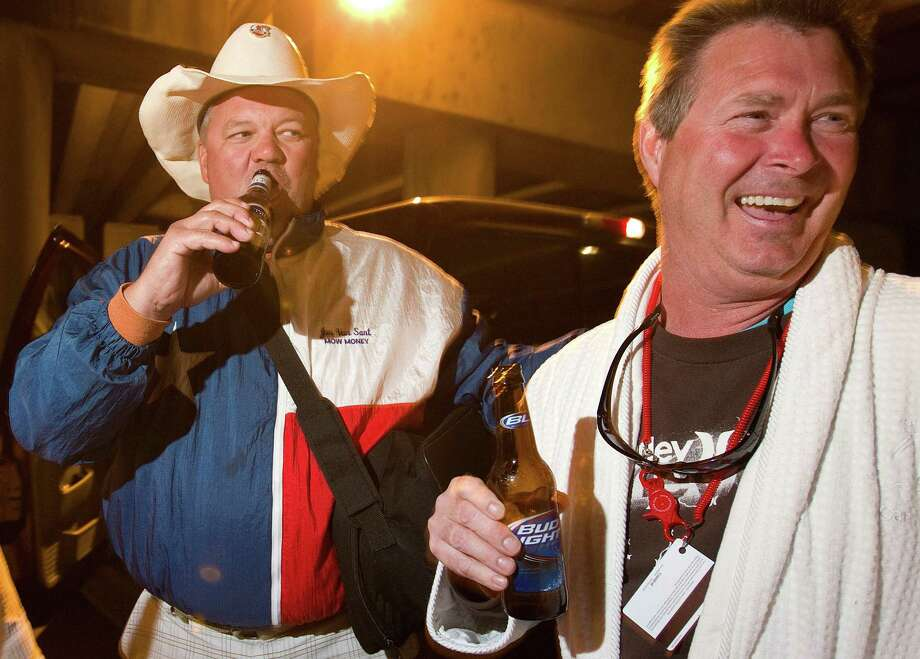 Jon Bansant, left, and Phillip Graham, of Seabrook, enjoy a cold beer they asked a friend meeting them in Mobile to bring. They were headed to New Orleans.  Photo: Johnny Hanson, Houston Chronicle / © 2013  Houston Chronicle