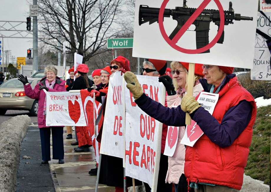 Grannies for Peace celebrate Valentine?s Day with a vigil calling for an end to gun violence, both at home and in war at the corner of Central Ave. and Wolf Rd. in Colonie Friday Feb. 14, 2013.  (John Carl D'Annibale / Times Union) Photo: John Carl D'Annibale / 00021166A