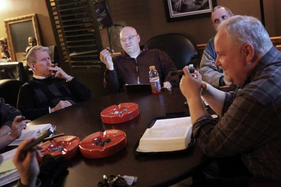 At a cigar store. The Rev. Eric Van Scyoc leads a Bible study in Ohio. Photo: Gus Chan, Associated Press / The Plain Dealer