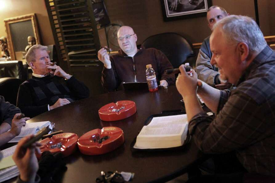 At a cigar store. The Rev. Eric Van Scyoc leads a Bible study in Ohio.