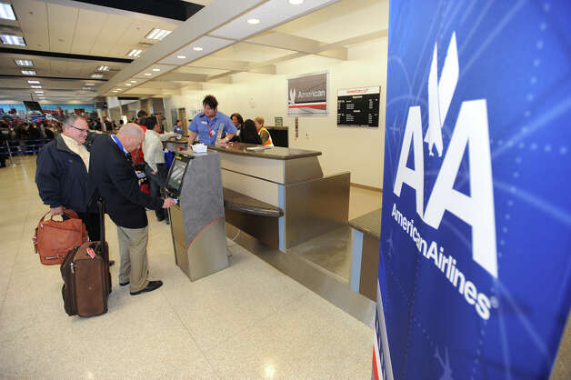 Passengers check in for American Airlines inaugural flight from the Jack Brooks Regional Airport on Thursday. Photo taken Thursday, February 14, 2013 Guiseppe Barranco/The Enterprise Photo: Guiseppe Barranco, STAFF PHOTOGRAPHER / The Beaumont Enterprise