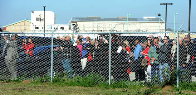 A crowd gathers at the runway gate to watch American Airline's first flight out of Southeast Texas Photo taken Thursday, February 14, 2013 Guiseppe Barranco/The Enterprise Photo: Guiseppe Barranco, STAFF PHOTOGRAPHER / The Beaumont Enterprise