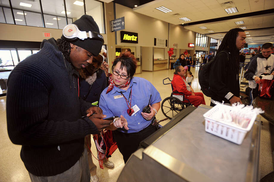 Toni Brown checks in for American Airlines first flight out of Southeast Texas on Thursday. Brown flew out of Beaumont to Idaho to attend the Simplot Games.   Photo taken Thursday, February 14, 2013 Guiseppe Barranco/The Enterprise Photo: Guiseppe Barranco, STAFF PHOTOGRAPHER / The Beaumont Enterprise
