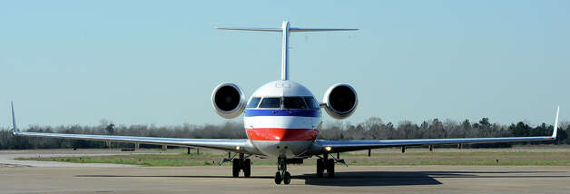 American Airlines jet plane on a Jack Brooks Regional Airport runway. Photo taken Thursday, February 14, 2013 Guiseppe Barranco/The Enterprise Photo: Guiseppe Barranco, STAFF PHOTOGRAPHER / The Beaumont Enterprise