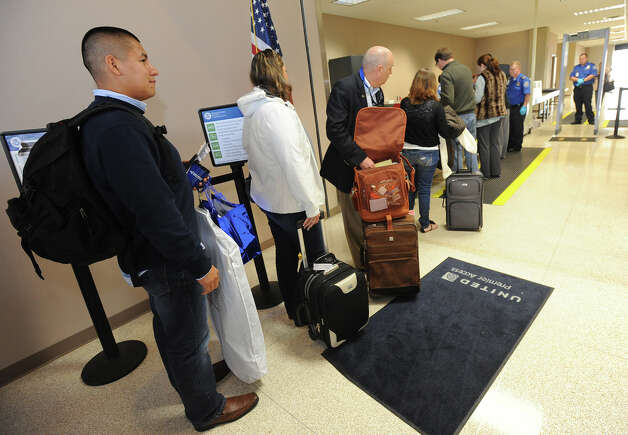 Hugo Gaytan waits in the security line at Jack Brooks Regional Airport on Thursday. Photo taken Thursday, February 14, 2013 Guiseppe Barranco/The Enterprise Photo: Guiseppe Barranco, STAFF PHOTOGRAPHER / The Beaumont Enterprise