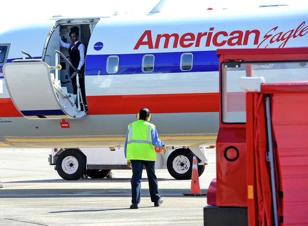 The door is shut before takeoff of American Airline's inaugural flight out  of the Jack Brooks Regional Airport on Thursday. Photo taken Thursday, February 14, 2013 Guiseppe Barranco/The Enterprise Photo: Guiseppe Barranco, STAFF PHOTOGRAPHER / The Beaumont Enterprise
