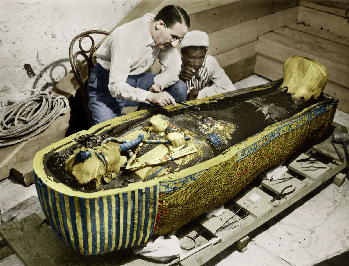 The tomb of King Tutankhamun was discovered in 1922, but it wasn't until the following year when archeologist Howard Carter was finally able to locate the burial chamber and discover the sarcophagus of the ancient king.In this colorized photograph, Howard Carter, the English Egyptologist, is seen near golden sarcophagus of Tutankhamun in Egypt in 1923.
