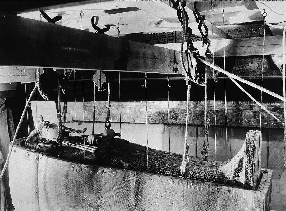 A gold coffin is lowered by rope and pulleys as a gold sarcophagus is hoisted up during the excavation of the tomb of Egyptian King Tutankhamun on Howard Carter's expedition, 1923. Photo: RDA, Getty Images / Getty 2013