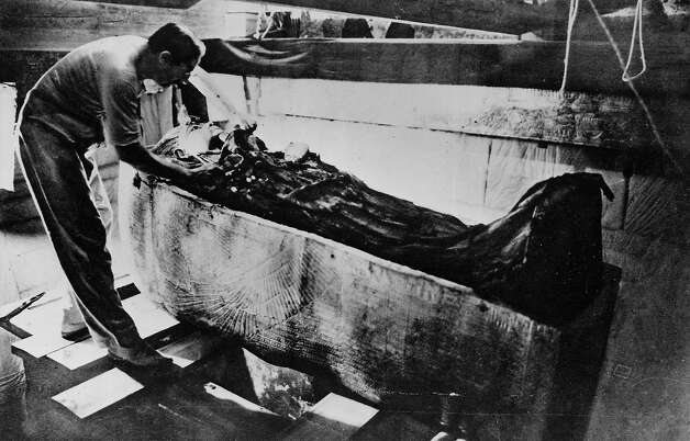 Archaeologist Howard Carter standing over the coffin of Tutankhamun, the ancient Egyptian pharaoh, in1923. Photo: Time Life Pictures, Time & Life Pictures/Getty Image / Getty 2013