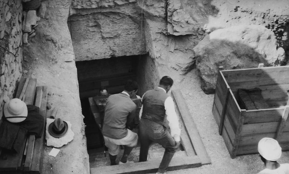 Crates are brought out of the newly-discovered tomb of Tutankhamun in the Valley of the Kings, Luxor, circa 1923.
