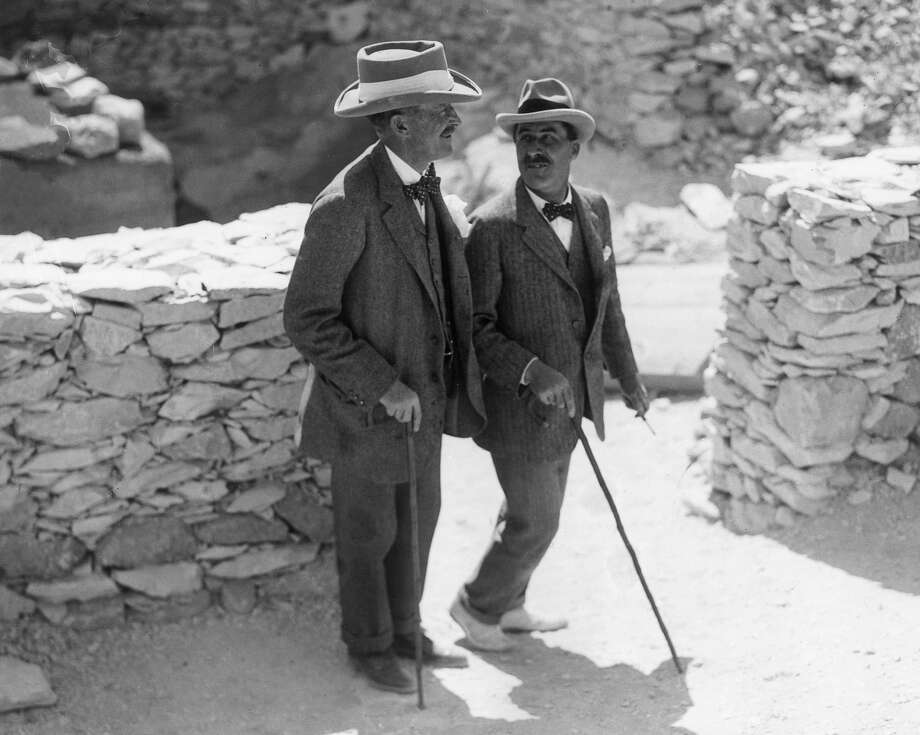 English Egyptologist Howard Carter (1874 - 1939, right) walks with the patron of his research, archaeologist and 5th Earl, Lord Carnarvon George Herbert (1866 - 1923), at the Valley of the Kings excavation site, Egypt. That year the pair discovered the tomb of King Tutankhamun. Photo: Hulton Archive, Getty Images / Getty 2013