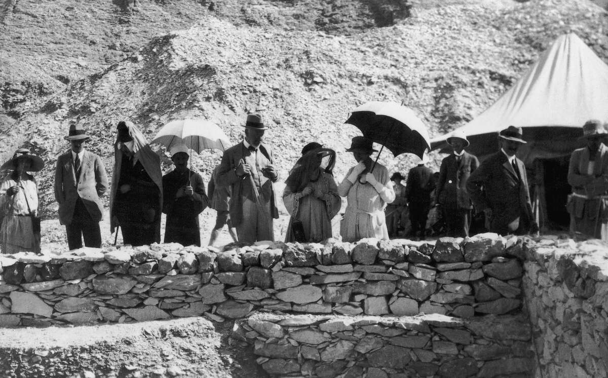Tourists and souvenir hunters visit the tomb of Egyptian pharaoh Tutankhamun, discovered by Howard Carter, in the Valley of the Kings in Luxor.