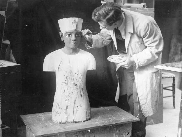 An artist retouches paint on a statue from the tomb of Tutankhamun for the Egyptian exhibit at Wembley. Photo: General Photographic Agency, Getty Images / Getty 2013