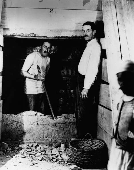 English Egyptologist Howard Carter and Mr. Mace opening the wall of the inner chamber of Tutankhamun
