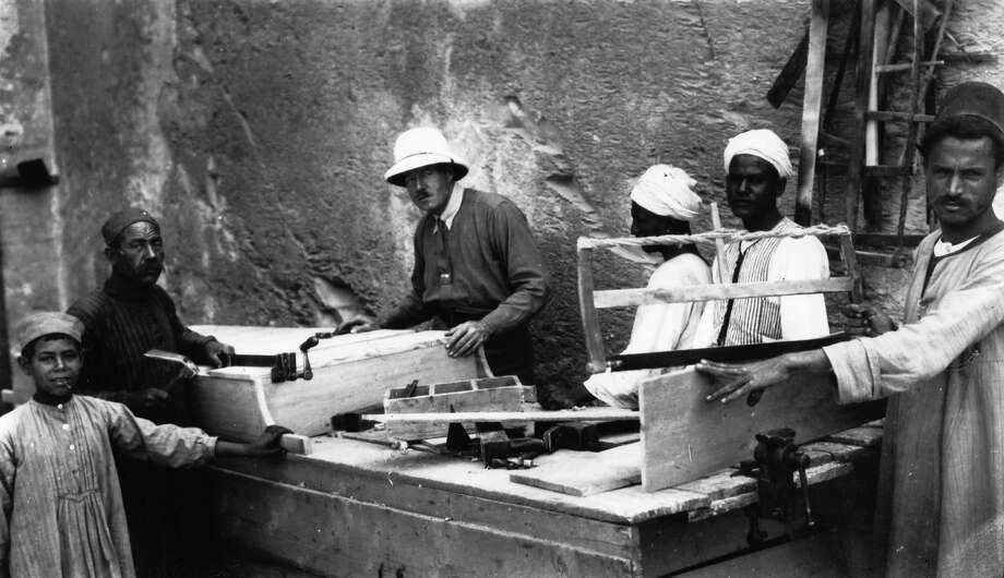 English Egyptologist Howard Carter supervising carpenters preparing to re-seal Tutankhamen's tomb. Photo: Hulton Archive, Getty Images / Getty 2013