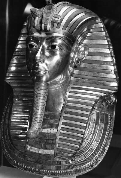 The gold mask placed over the head of the mummy of  Tutankhamen, buried in his tomb at Thebes in the