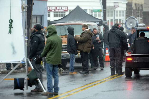"Actors and production staff on the set of Jennifer Aniston's new movie, based on the Elmore Leonard novel ""The Switch,"" shoot scenes inside and outside the Two Door Restaurant in Greenwich, Conn., Monday, Feb. 11, 2013. Photo: Helen Neafsey / Greenwich Time"