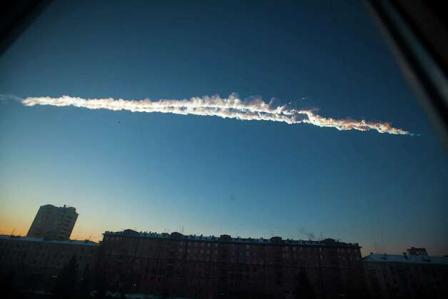 In this photo provided by Chelyabinsk.ru a meteorite contrail is seen over Chelyabinsk on Friday, Feb. 15, 2013. A meteor streaked across the sky of Russia's Ural Mountains on Friday morning, causing sharp explosions and reportedly injuring around 100 people, including many hurt by broken glass. Photo: Chelyabinsk.ru
