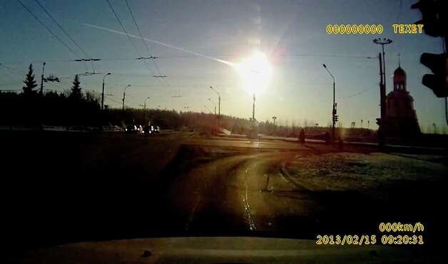 In this frame grab made from a video done with a dashboard camera a meteor streaks through the sky over Chelyabinsk, about 1500 kilometers (930 miles) east of Moscow,  Friday, Feb. 15, 2013. A meteor that scientists estimate weighed 10 tons (11 tons) streaked at supersonic speed over Russia's Ural Mountains on Friday, setting off blasts that injured some 500 people and frightened countless more. (AP Photo/AP Video) Photo: Associated Press