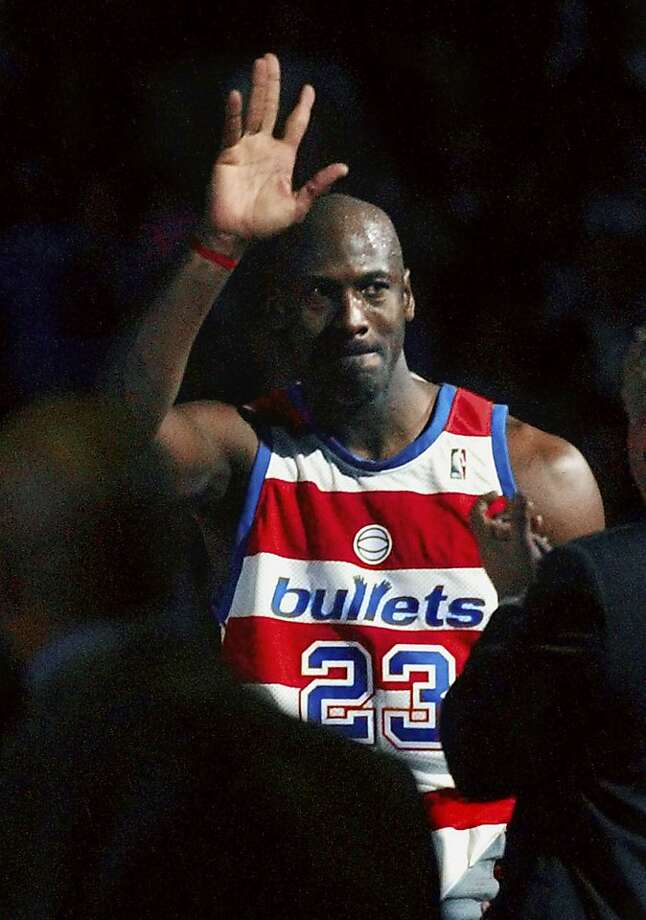 Washington Wizards' Michael Jordan waves goodbye to his fans after his final home game against the New York Knicks at the MCI Center Monday, April 14, 2003. Photo: Dick Druckman, AP