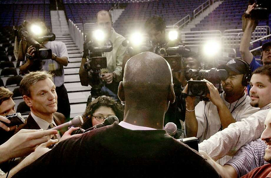 Michael Jordan, always in the spotlight, talks to members of the media after the team's shoot around in 2001.  Photo: Eric Gay, Associated Press