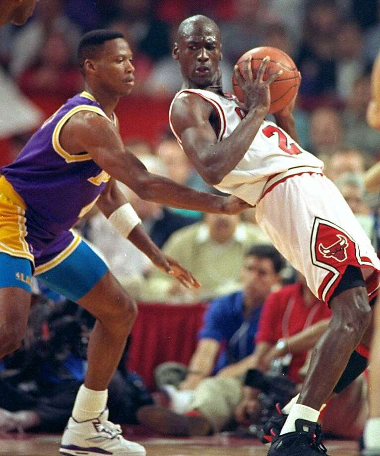 Los Angeles Lakers guard Byron Scott checks Michael Jordan during the third quarter of Game 2 of the NBA Finals in Chicago in this June 6, 1991 photo. Photo: John Swart, Associated Press