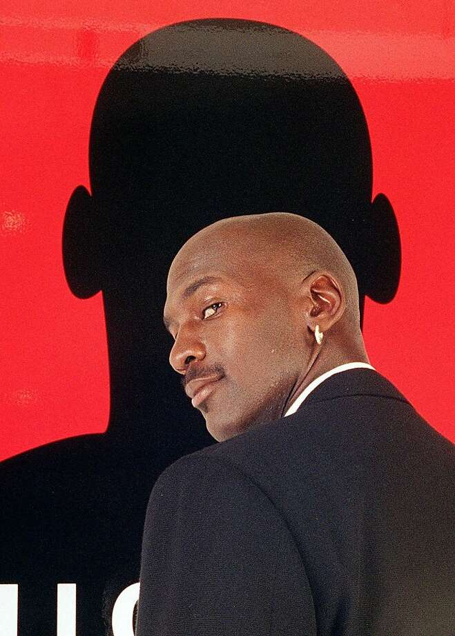 "Michael Jordan pauses during a 1996 event to launch his signature fragrance ""Michael Jordan Cologne.""  Photo: Mark J Terrill, Associated Press"