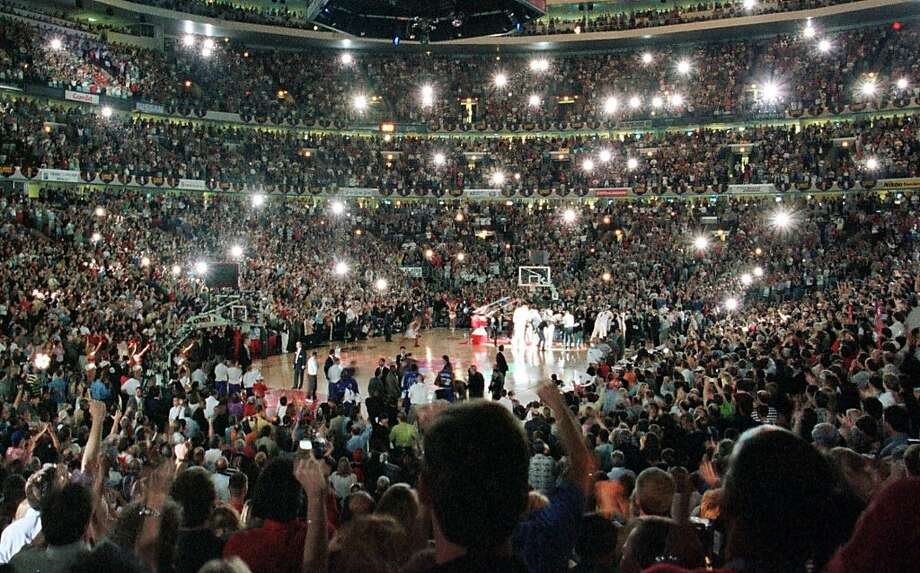 Cameras flash as the Chicago Bulls are introduced before Game 5 of the NBA Finals against the Utah Jazz on Friday, June 12, 1998, at the United Center in Chicago. Photo: Michael Conroy, Associated Press