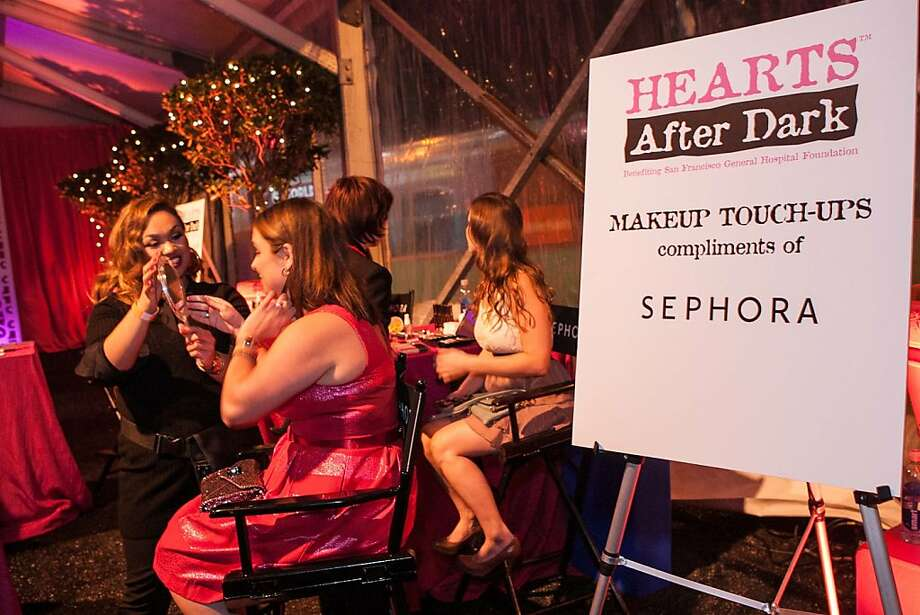 Guests enjoy makeup retouches during the Hearts After Dark event, which gave AT&T Park a Valentine's Day-inspired makeover of its own. Photo: Drew Altizer Photography