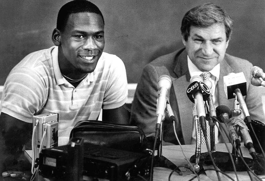 UNC guard Michael Jordan and Tar Heels coach Dean Smith are shown at a news conference in this May 5, 1984 photo in Chapel Hill, N.C., where Jordan announced he would go pro during  his last year of college. Photo: File, Associated Press
