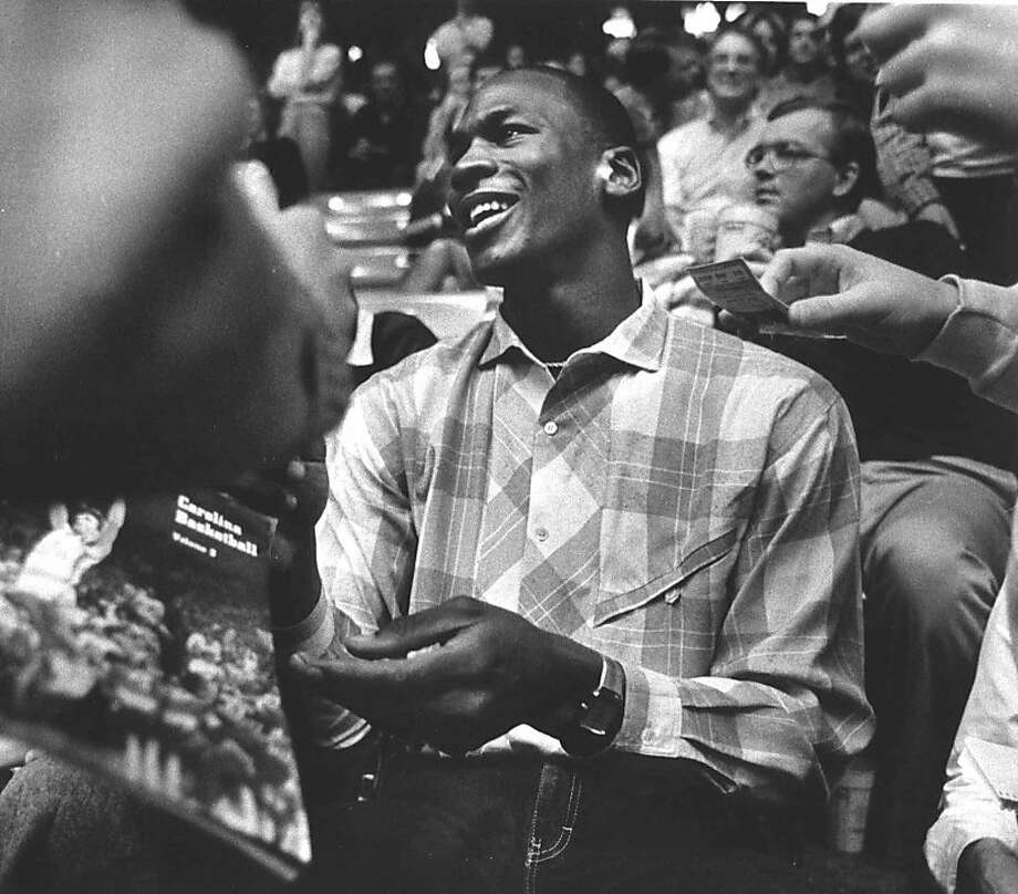 Then-Chicago Bull Michael Jordan watches his alma mater North Carolina play Georgia Tech in this Jan. 31, 1985 photo in Chapel Hill, N.C. Photo: File, Associated Press