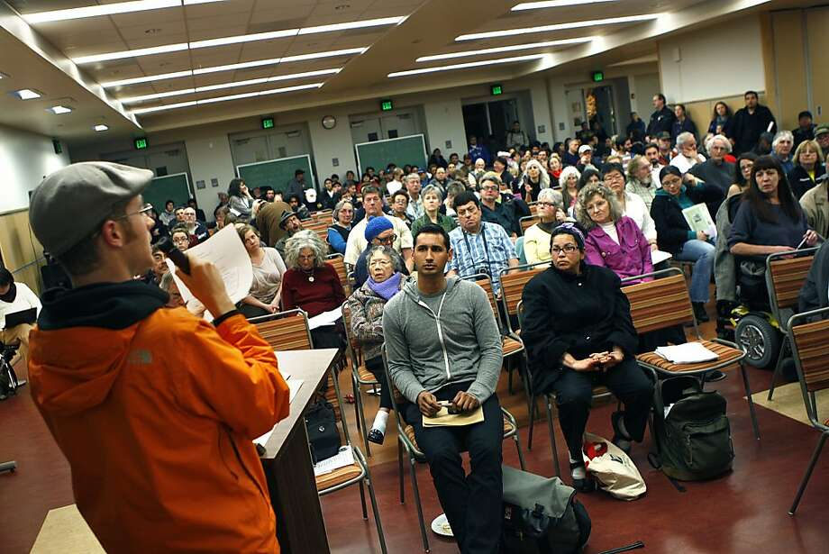 Eric Blanc, a student at the troubled City College of San Francisco, speaks during a public meeting held by the Save City College Coalition in San Francisco. Photo: Liz Hafalia, The Chronicle