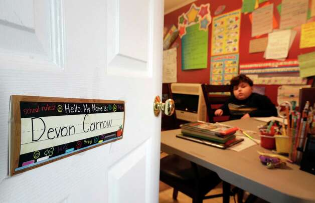 In this Tuesday, Jan. 22, 2013 photo, Devon Carrow attends school from home while operating a robot in the classroom, in Orchard Park N.Y. Carrow's life-threatening allergies don't allow him to go to school. But the 4-foot-tall robot with a wireless video hookup gives him the school experience remotely. (AP Photo/David Duprey) Photo: David Duprey