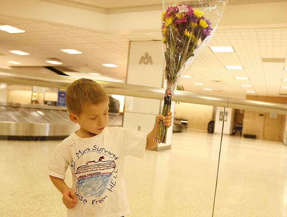 Carnival passenger Marco Chivleatto, 4,of Katy waits at Bush Intercontinental Airport. (Nick de la Torre/Chronicle)