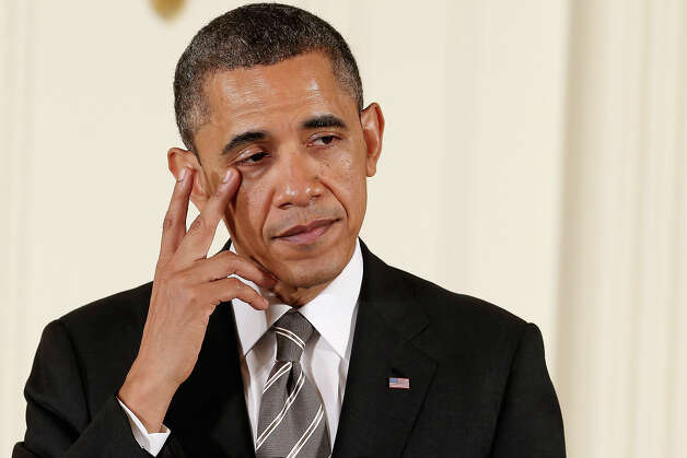 "President Barack Obama wipes a tear from the corner of his eye before presenting recipients with the 2012 Presidential Citizens Medal, the nation's second-highest civilian honor, in the East Room of the White House February 15, 2013 in Washington, DC. ""Their selflessness and courage inspire us all to look for opportunities to better serve our communities and our country,"" Obama said about this year's recipients. Photo: Chip Somodevilla, Getty Images / 2013 Getty Images"