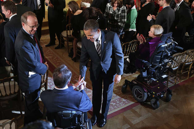 "President Barack Obama greets guests after presenting recipients with the 2012 Presidential Citizens Medal, the nation's second-highest civilian honor, in the East Room of the White House February 15, 2013 in Washington, DC. ""Their selflessness and courage inspire us all to look for opportunities to better serve our communities and our country,"" Obama said about this year's recipients. Photo: Chip Somodevilla, Getty Images / 2013 Getty Images"