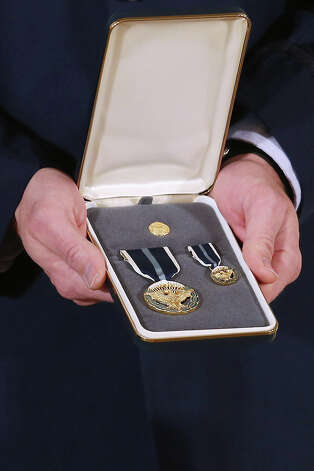 "A 2012 Presidential Citizens Medal, the nation's second-highest civilian honor, that President Barack Obama will present to recipients is held in the East Room of the White House February 15, 2013 in Washington, DC. ""Their selflessness and courage inspire us all to look for opportunities to better serve our communities and our country,"" Obama said about this year's recipients. Photo: Chip Somodevilla, Getty Images / 2013 Getty Images"