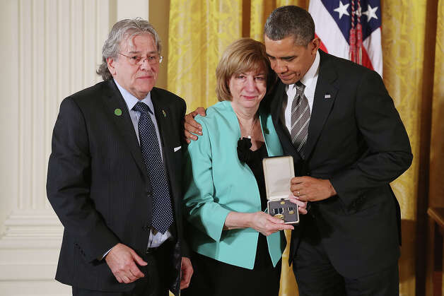 "President Barack Obama presents Terri Rousseau and Gilles Rousseau; with the 2012 Presidential Citizens Medal, the nation's second-highest civilian honor, on behalf of their daughter Lauren Rousseau in the East Room of the White House February 15, 2013 in Washington, DC. First grade teacher Lauren Rousseau was killed during a mass shooting that left 26 people dead at Sandy Hook Elementary School in December 2012. ""Their selflessness and courage inspire us all to look for opportunities to better serve our communities and our country,"" Obama said about this year's recipients. Photo: Chip Somodevilla, Getty Images / 2013 Getty Images"