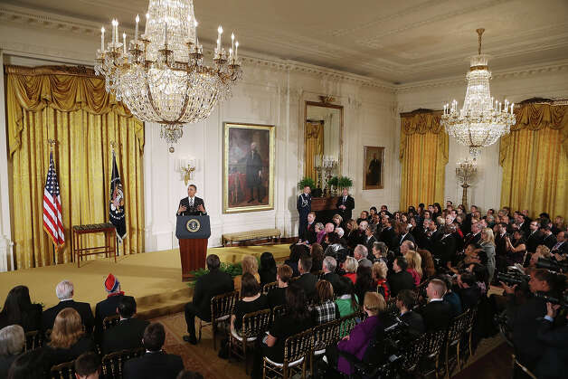 "President Barack Obama delivers remarks before presenting recipients with the 2012 Presidential Citizens Medal, the nation's second-highest civilian honor, in the East Room of the White House February 15, 2013 in Washington, DC. ""Their selflessness and courage inspire us all to look for opportunities to better serve our communities and our country,"" Obama said about this year's recipients. Photo: Chip Somodevilla, Getty Images / 2013 Getty Images"